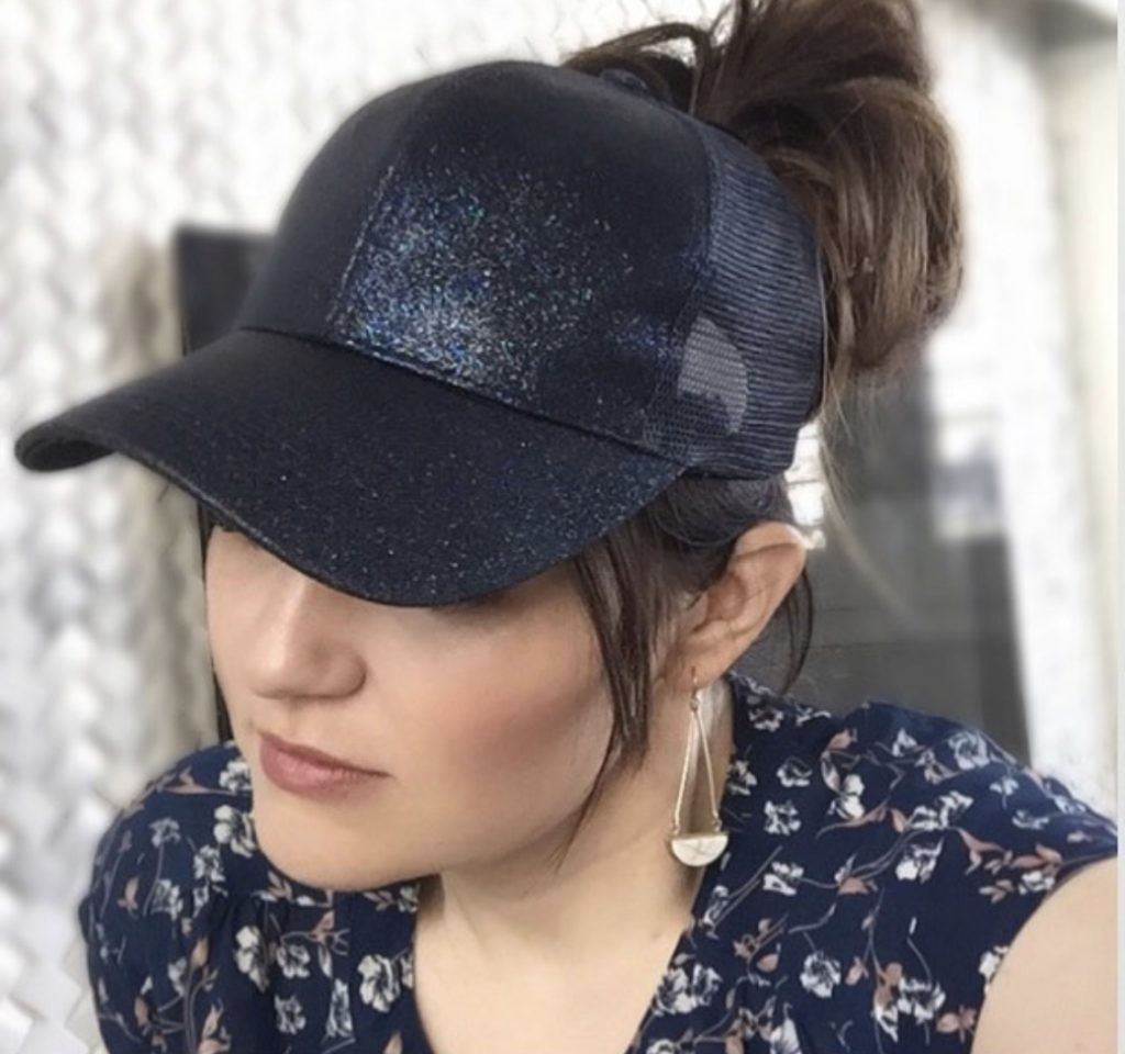 Messy Bun Hats - The best fifth day hair hack by Popular Utah Blogger and Top Maskcara Beauty Artist, Kelly Snider; image of woman wearing a navy blue sparkly messy bun.