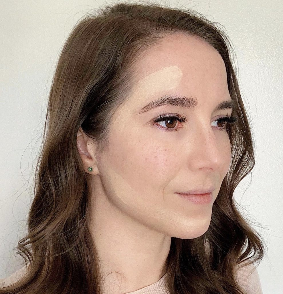 How to Contour in 5 Easy Steps by popular beauty blogger and top artist with Maskcara Beauty, Kelly Snider; Image of of first step applying the main highlight color.