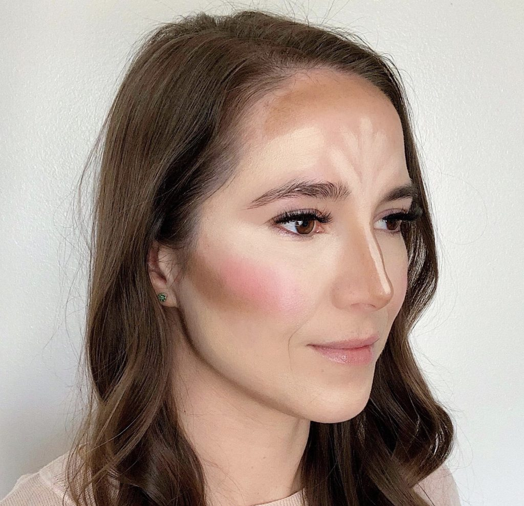 How to Contour in 5 Easy Steps by popular beauty blogger and top artist with Maskcara Beauty, Kelly Snider; Image of fourth step applying the lip+cheek color.