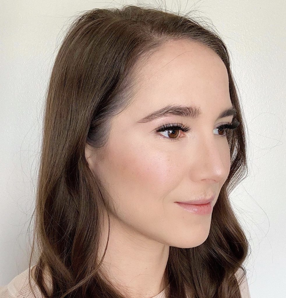 How to Contour in 5 Easy Steps by popular beauty blogger and top artist with Maskcara Beauty, Kelly Snider; Image of fifth step applying illuminator after blending.