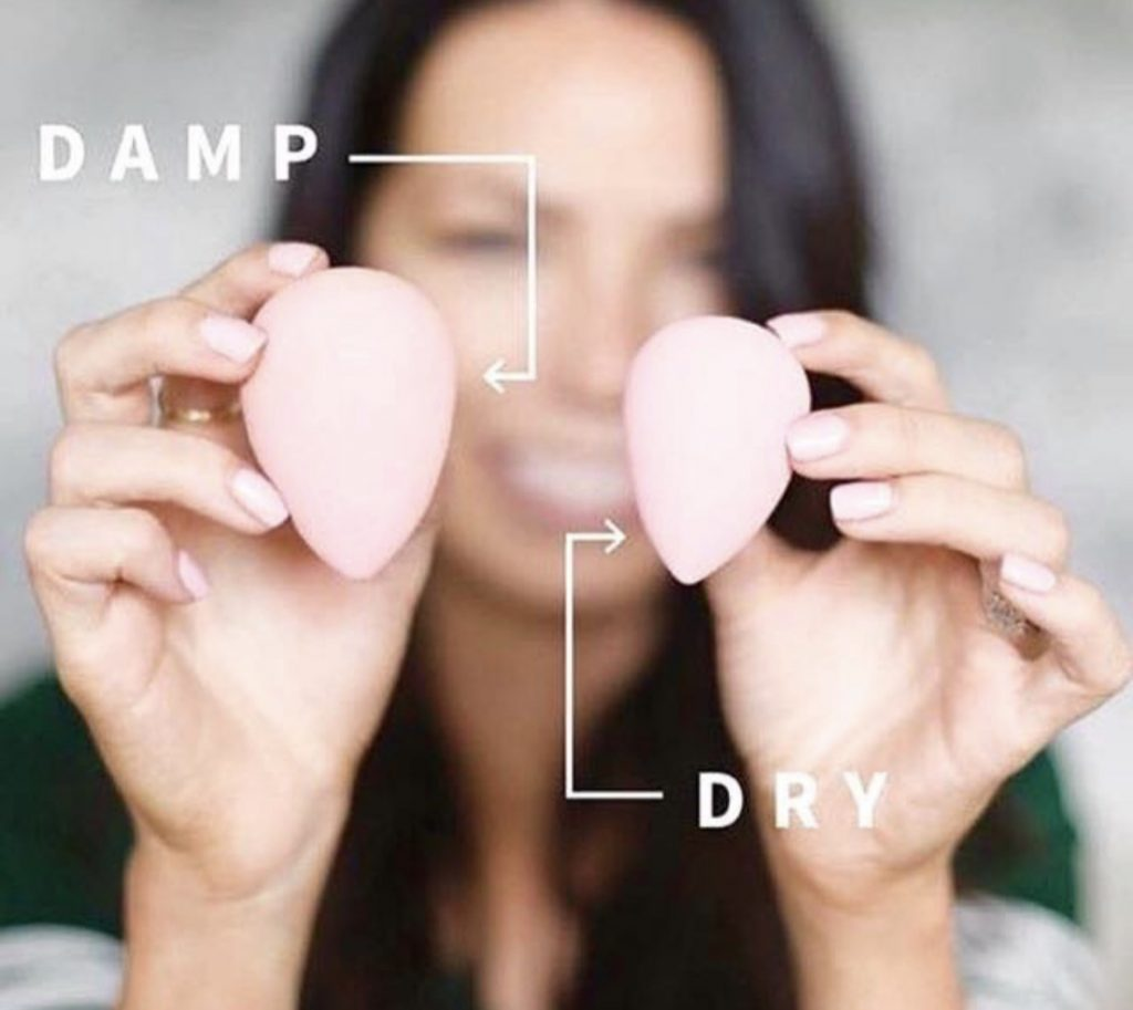 How to use a makeup sponge in 3 simple steps by popular blogger and seint artist, Kelly Snider. Image of a Cara Brooke holding a wet and dry seint perfector sponge.
